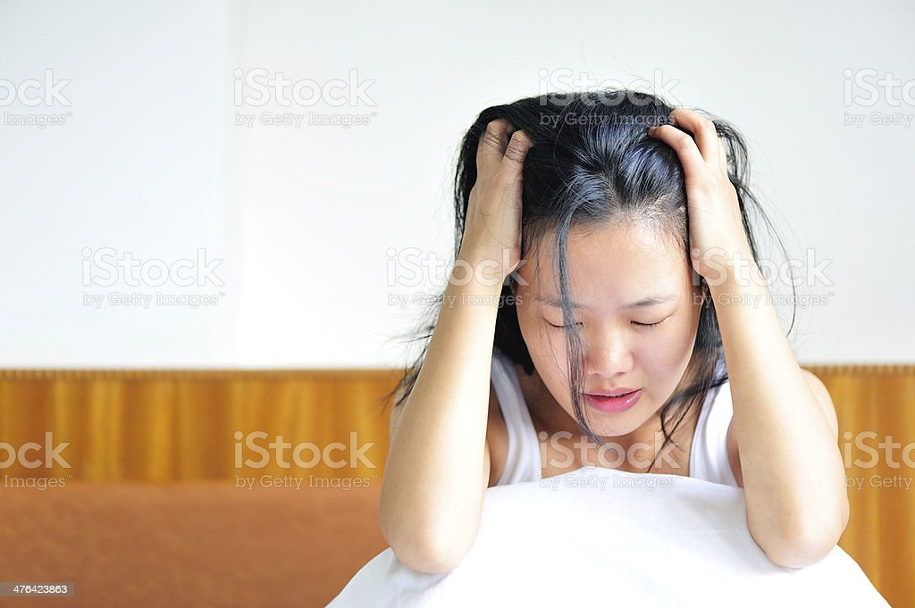 sad young woman scratching her head stock photo