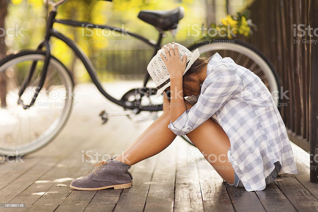 sad young woman sitting at the park royalty-free stock photo