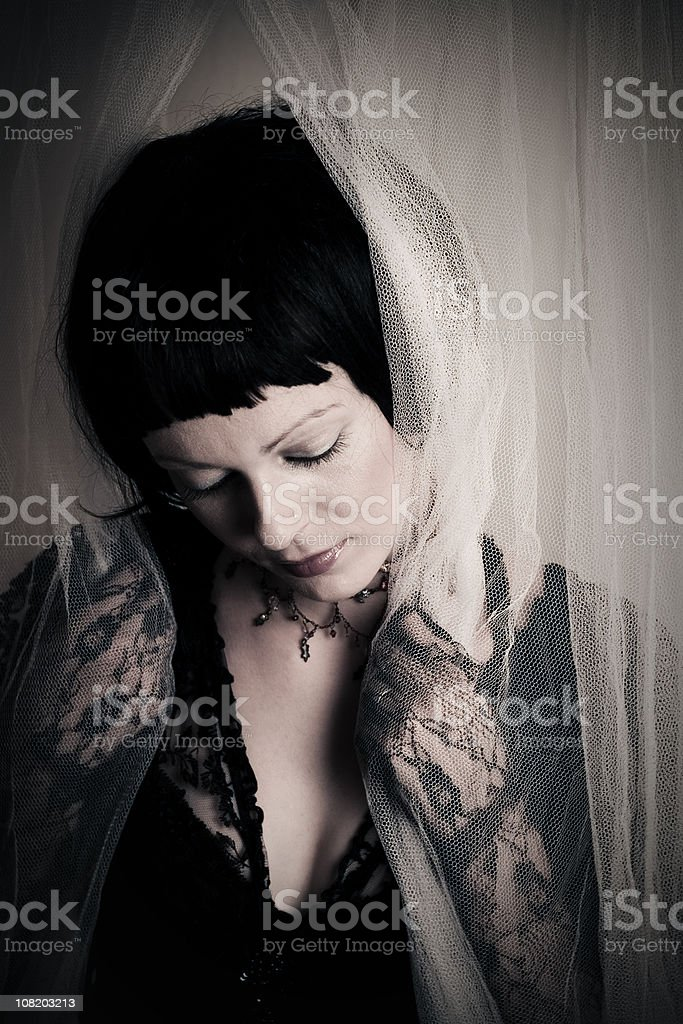 Sad Young Woman Wearing Black Lace stock photo