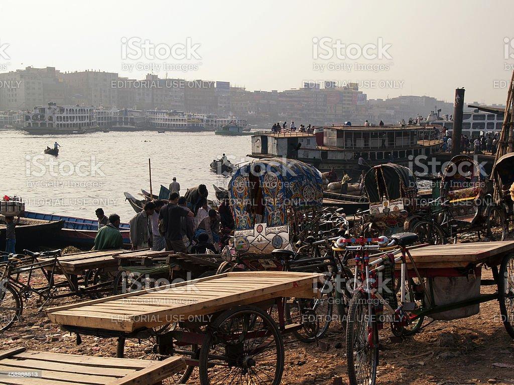 \'Dhaka, Bangladesh - January 23, 2012: Boatmans who earns a living by...