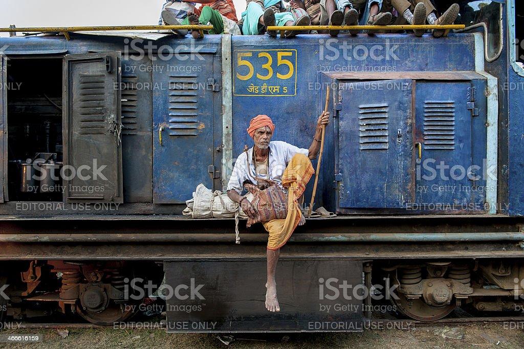 Saddhu is sitting on the side of locomotive stock photo