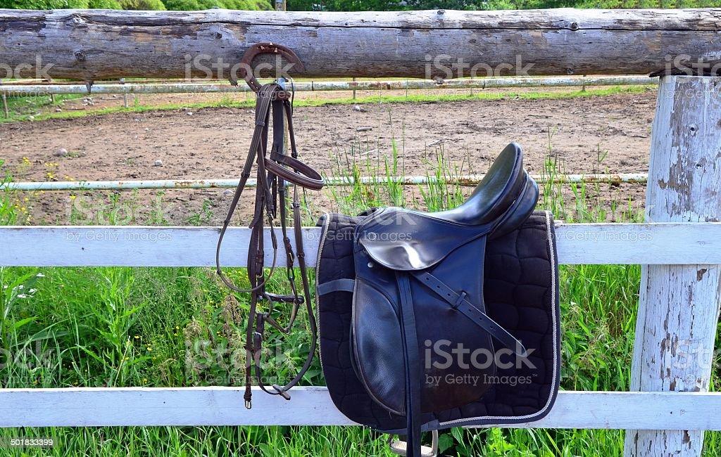 Saddle on fence stock photo