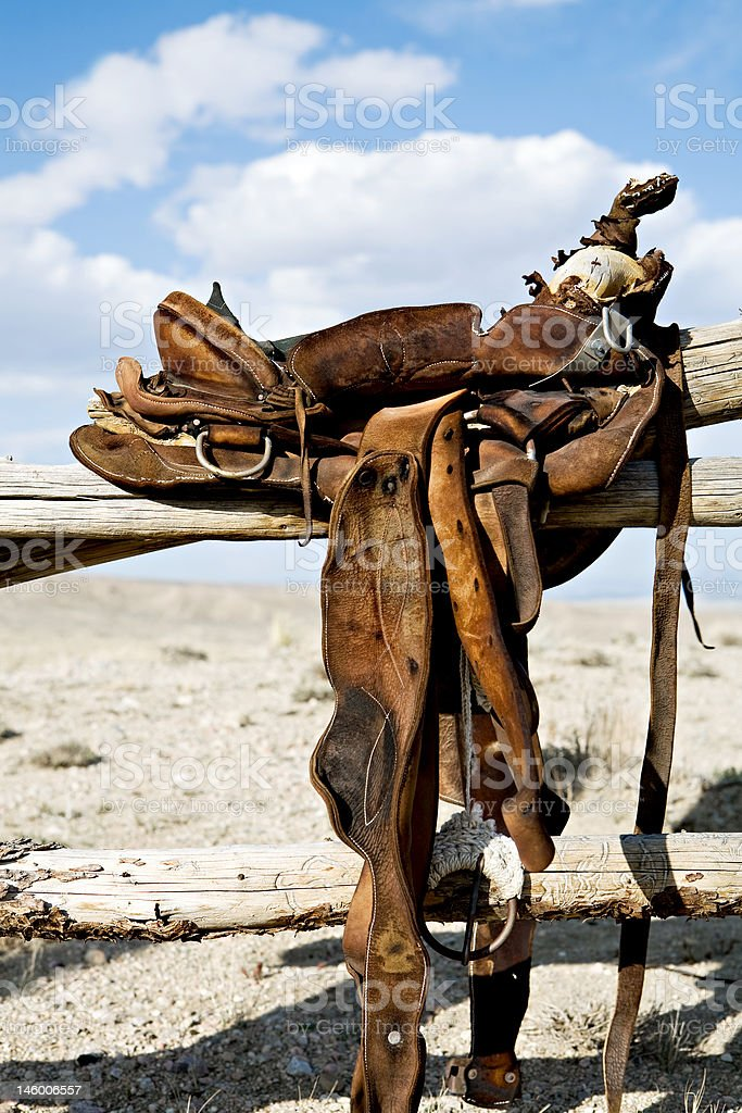 saddle on rural fence royalty-free stock photo