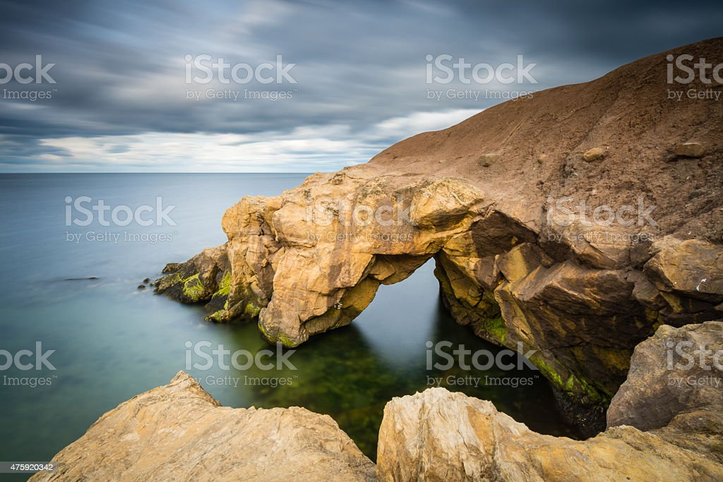 Saddle Rocks in smooth water stock photo