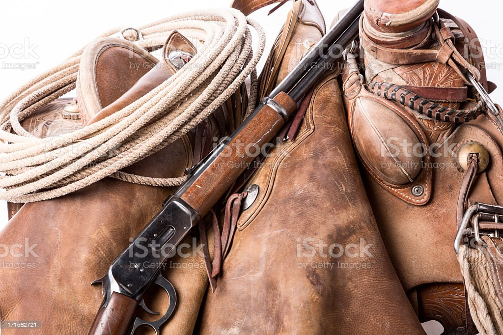 Saddle with Gun and Rope royalty-free stock photo