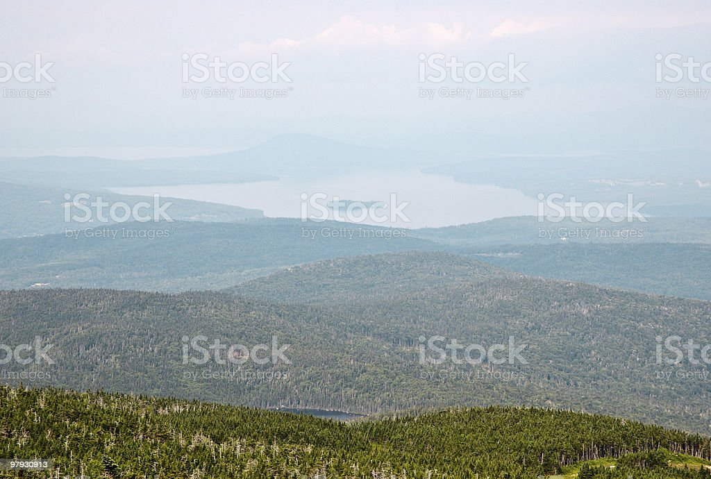 Saddleback Mountain and view of forested hills stock photo