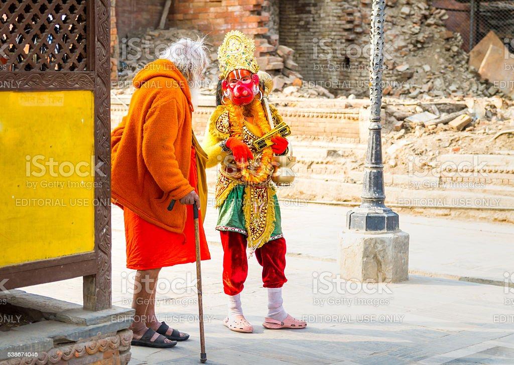 Sadhu Baba talking to Hanuman or Entellus stock photo