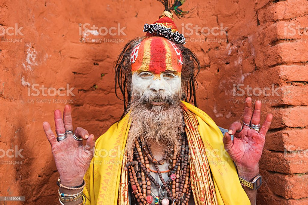 Sadhu - indian holyman sitting in the temple, Kathmandu, Nepal stock photo