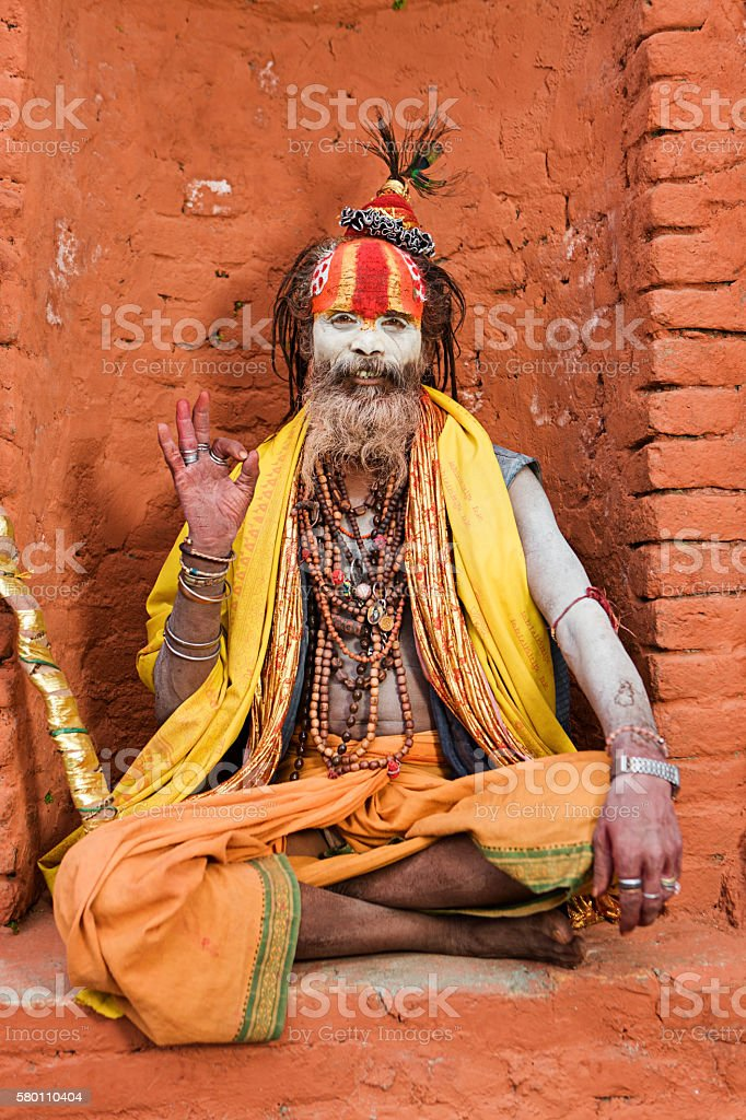 Sadhu - Indian holyman sitting in the temple, Kathmandu, Nepal stock photo