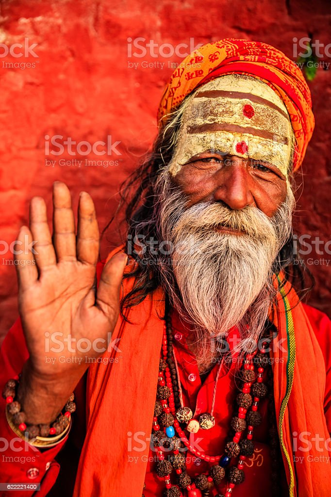 Sadhu - indian holyman sitting in the temple stock photo
