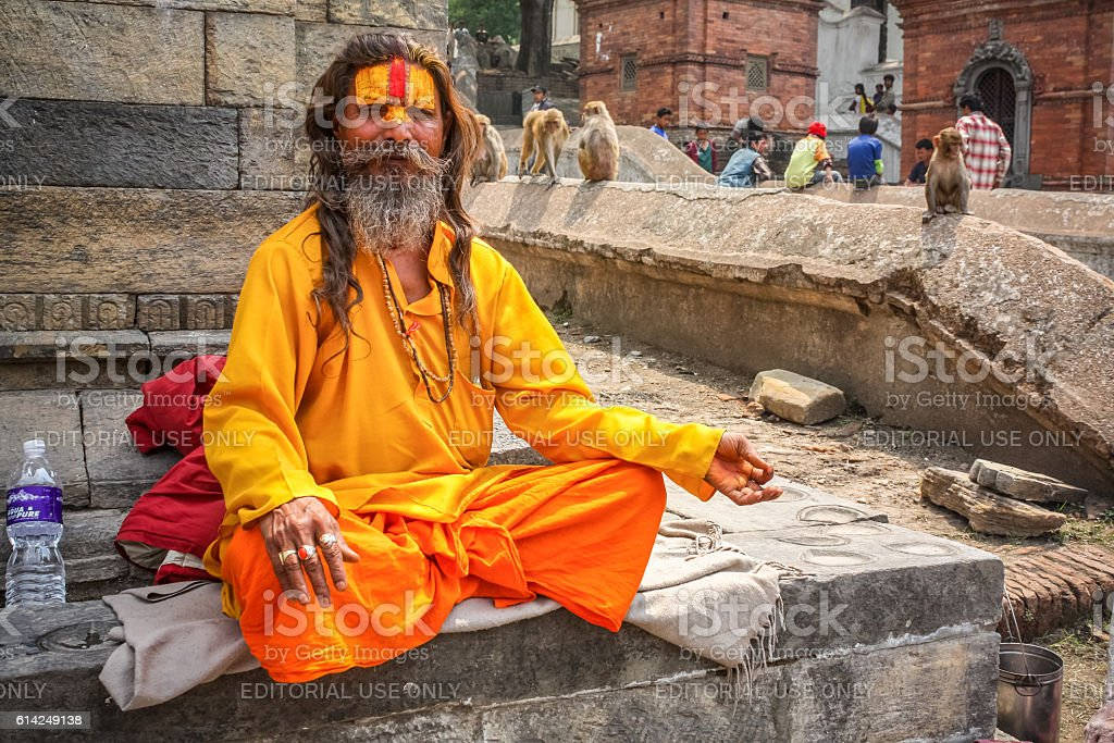 Sadhu Meditates at Pashupatinath Temple Kathmandu Nepal stock photo