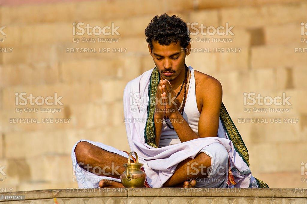 Sadhu meditating on the bank of Ganges River, India stock photo
