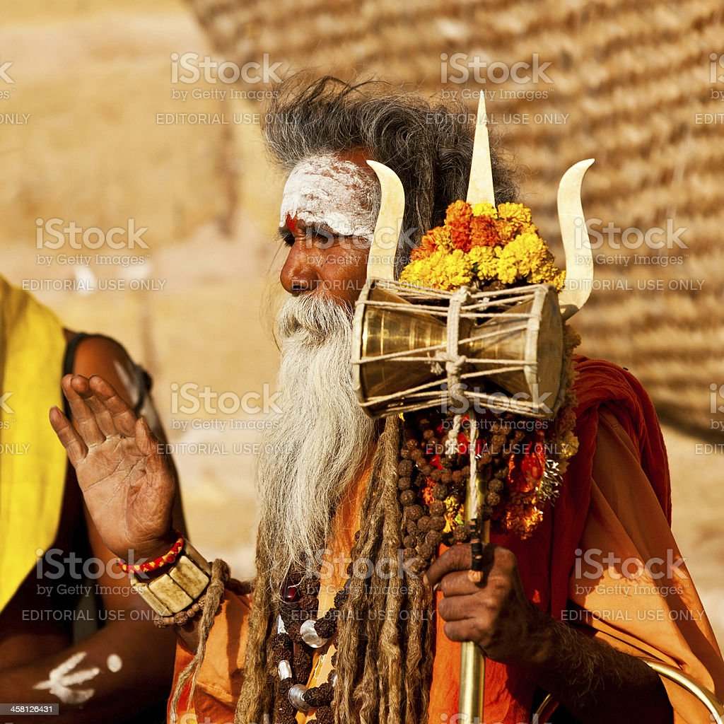 Sadhu seeking alms on the street in Varanasi, India royalty-free stock photo