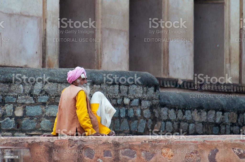 Sadhu sitting near Temple on the street in Orchha stock photo