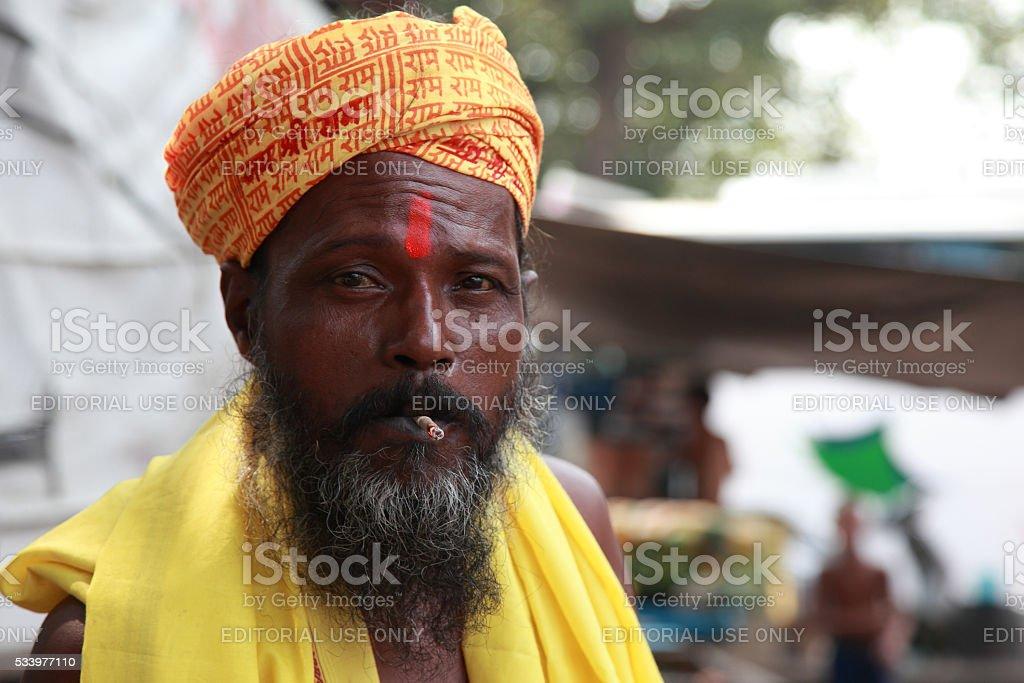 Sadhu smoking bidi stock photo