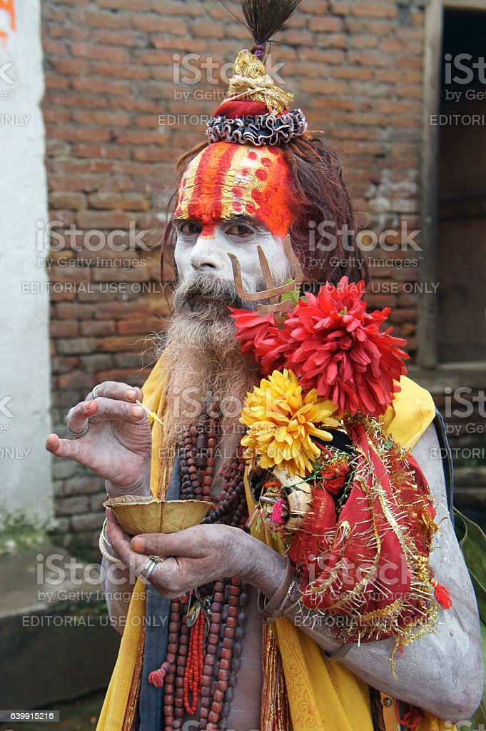 sadhu with snack in Pashupatinath, Kathmandu stock photo