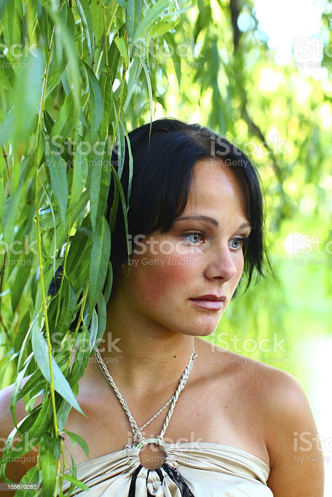 Sadness girl and weeping willow stock photo
