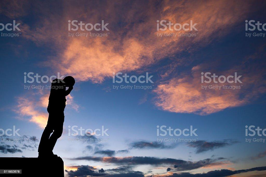 sadness man sihouette sunset nature stock photo