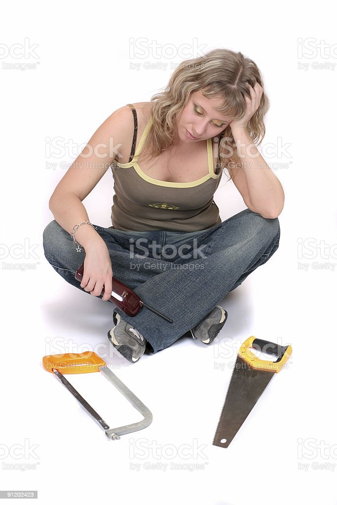 sadness woman with phone and  saw royalty-free stock photo