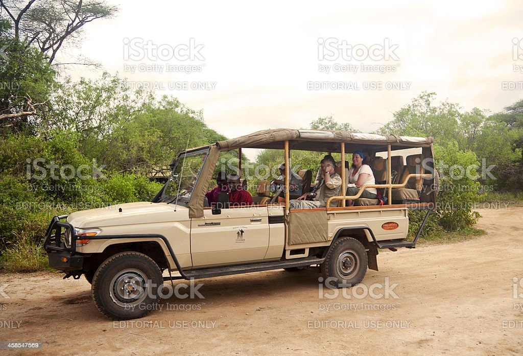 Safai vehicle with tourists and maasai ready to take off stock photo