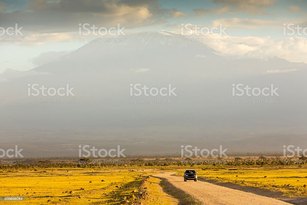 safari car at Amboseli with clouds stock photo