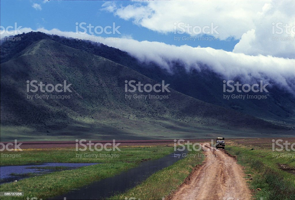 Safari car in the rough track inside Ngorongoro Crater, Tanzania stock photo