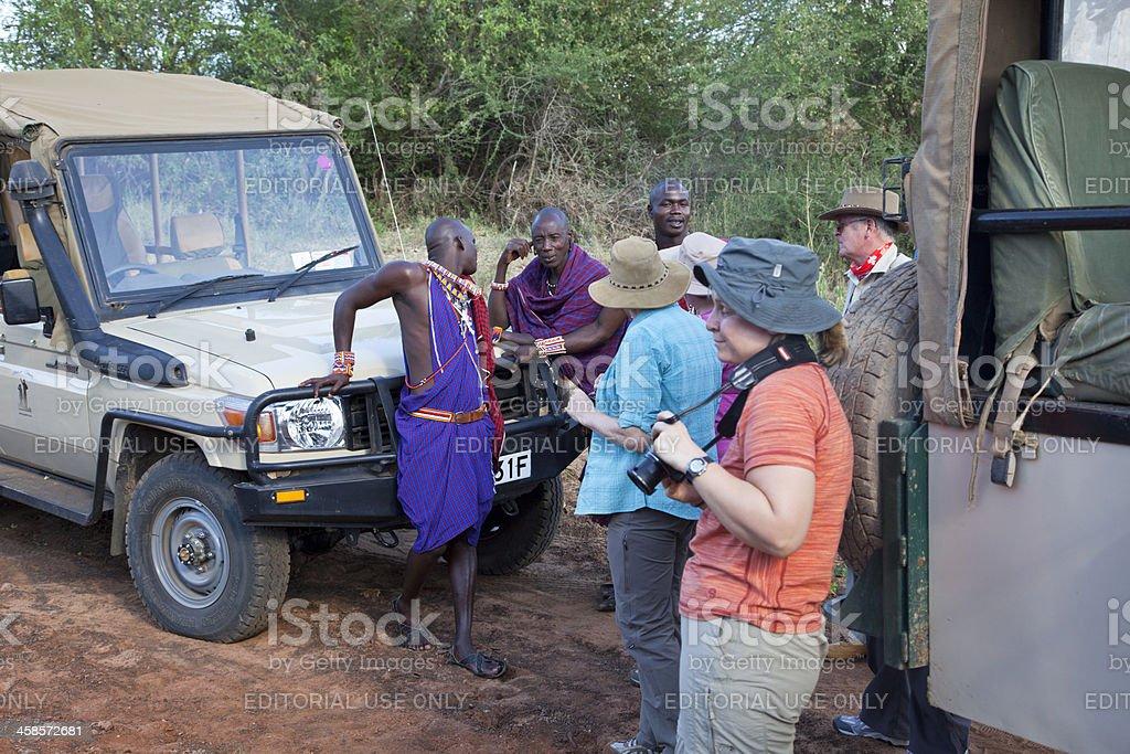 Safari, tourists with guides in maasai land. stock photo