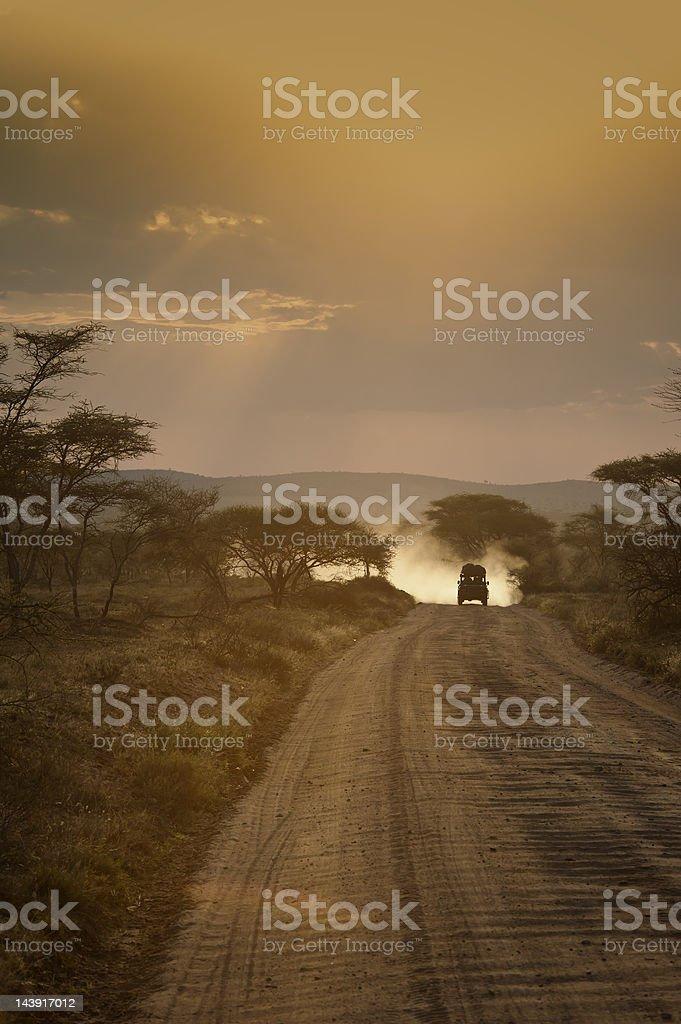 Safari vehicle at sunset, Serengeti, Africa stock photo
