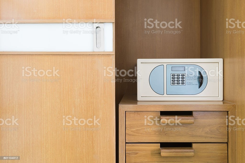 Safe box and wood wardrobe  in hotel stock photo
