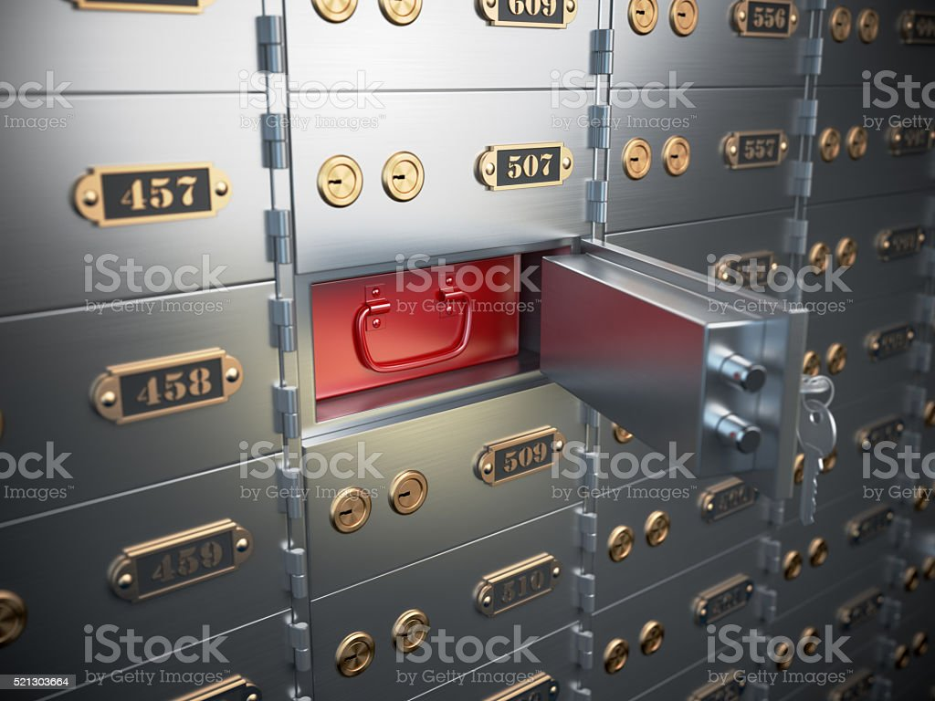 Safe deposit boxes with open one  cell. stock photo