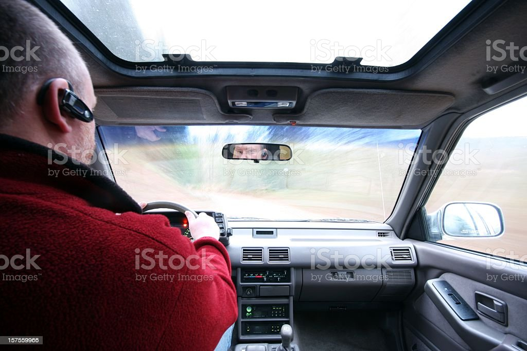 Safe Driving With Hands-Free Cell Phone stock photo