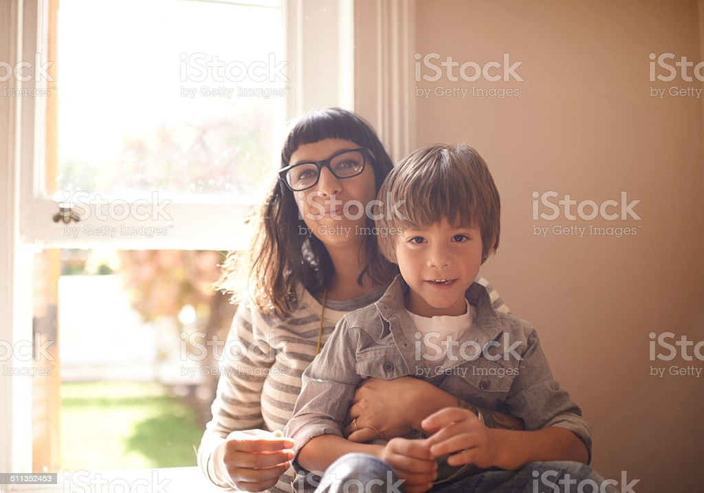 Safe in his Mom's embrace stock photo