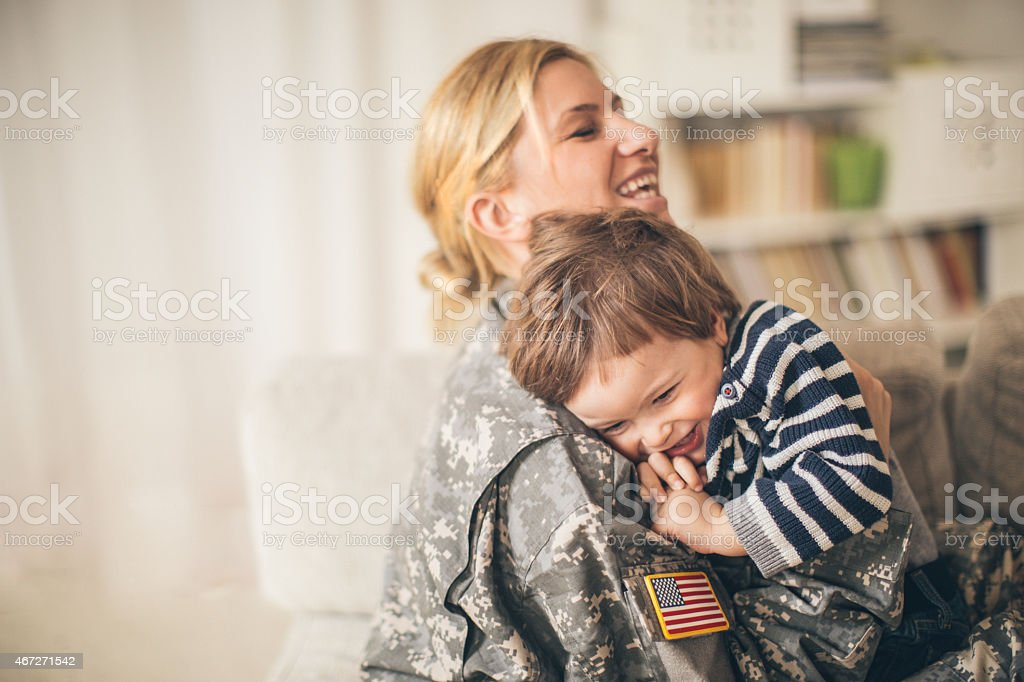 Safe in mommy soldier's hug stock photo