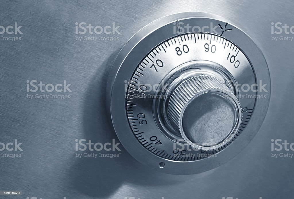 Safe lock dial in grey and metal stock photo