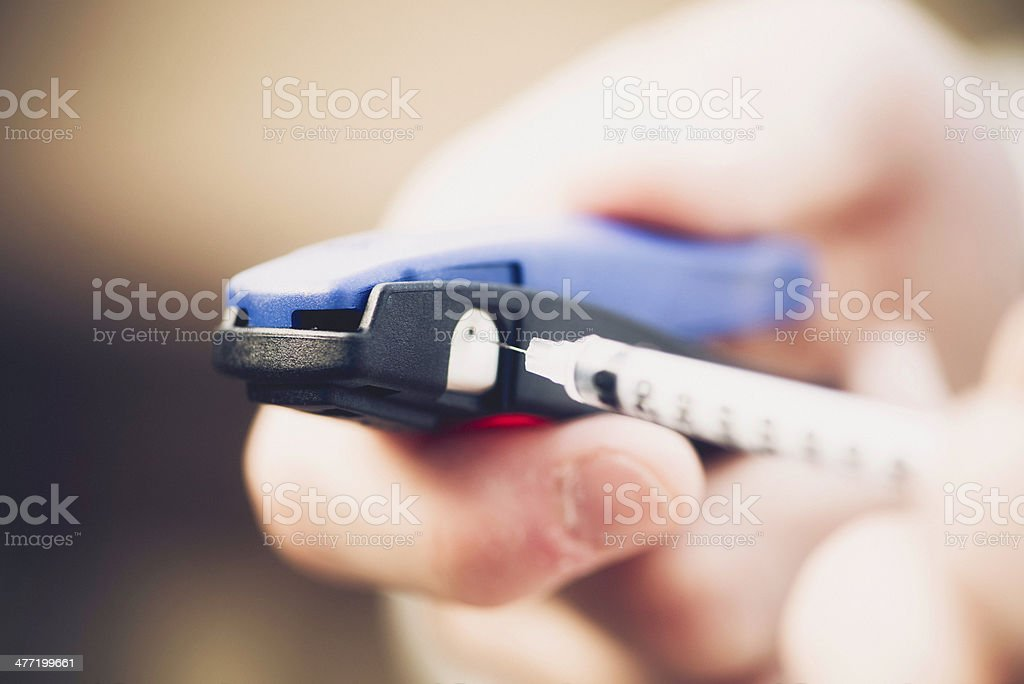 Safe Removal of Needle Tip From Insulin Syringe stock photo
