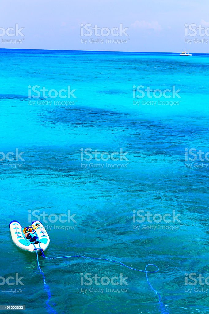 Safe rescue! Turquoise caribbean sea, boat and Yacht, Aruba, Antilles stock photo