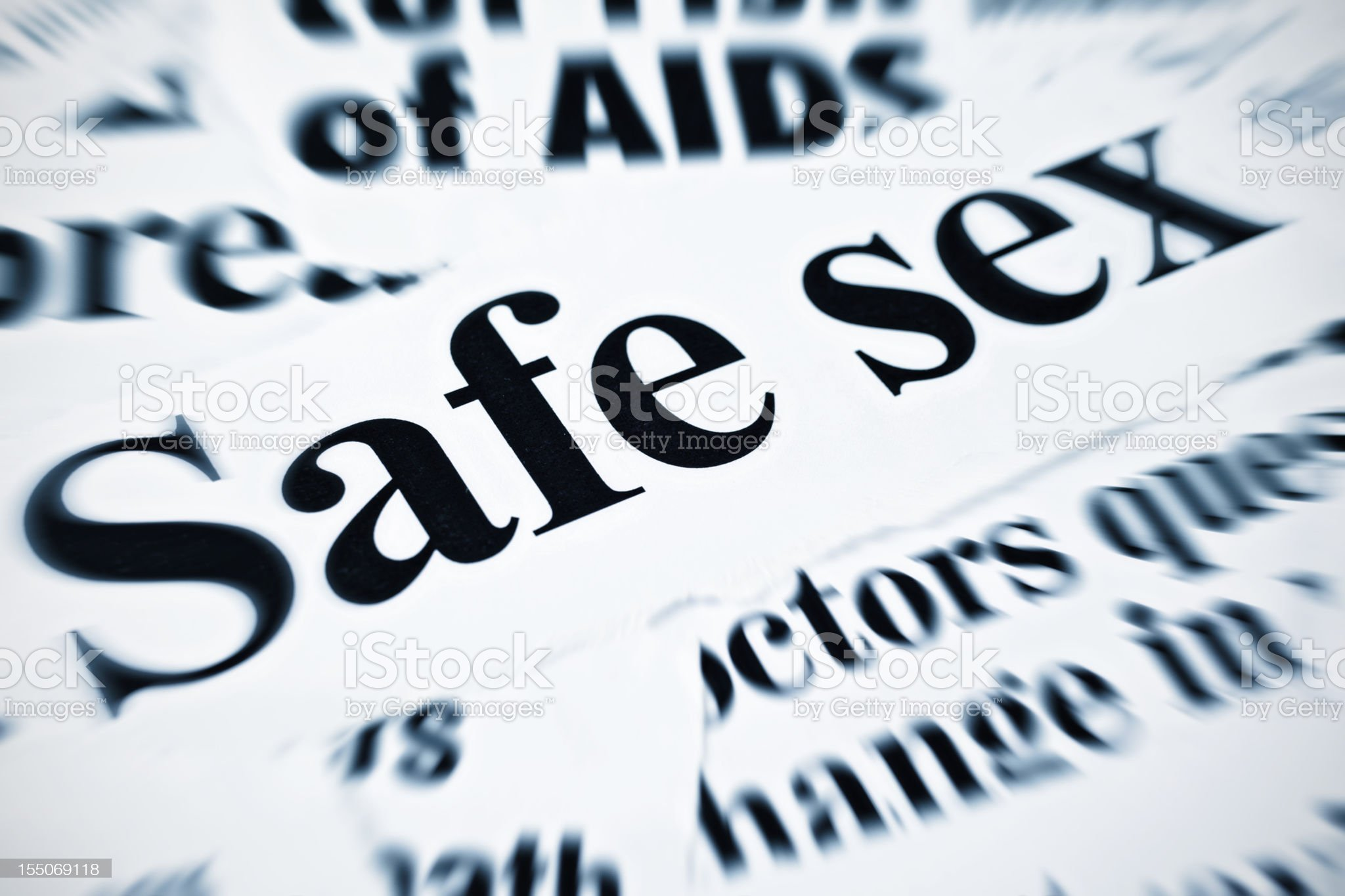 Safe sex and AIDS feature amongst newspaper headlines royalty-free stock photo