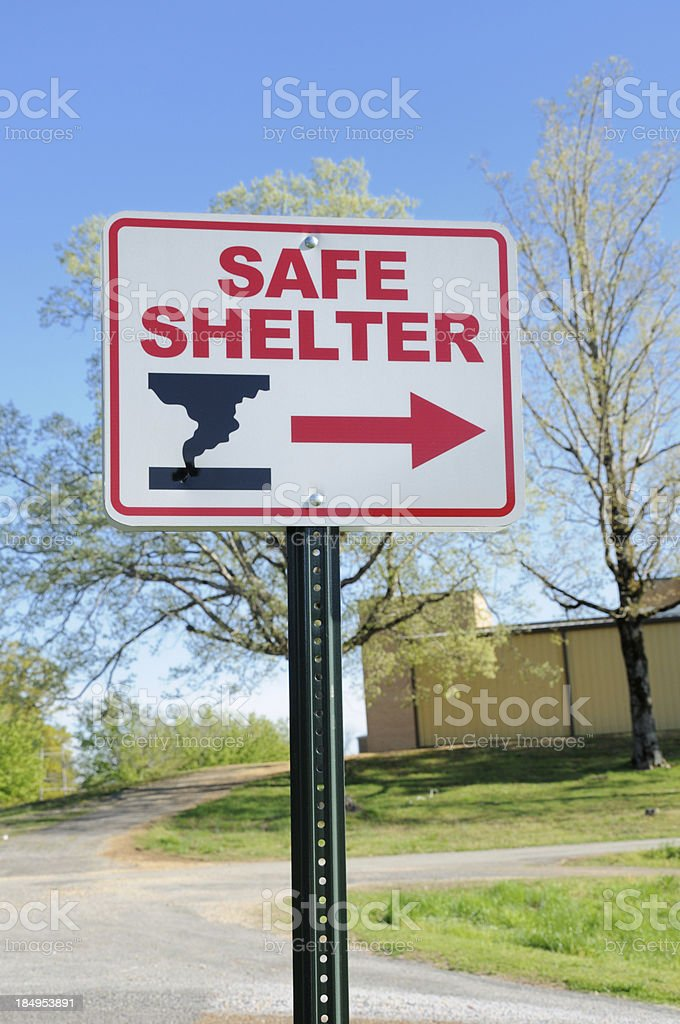 Safe shelter directional sign stock photo