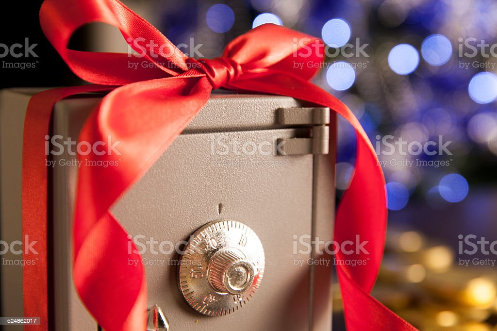 Safe with the ribbon and christmas decoration stock photo