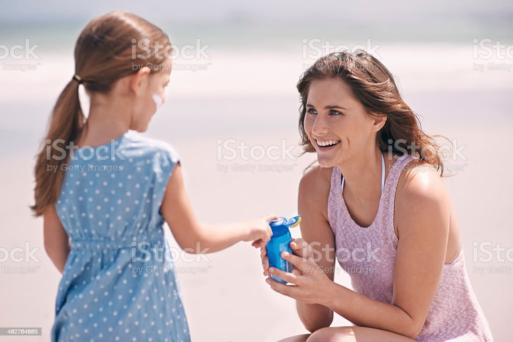 Safeguarding her against the sun stock photo