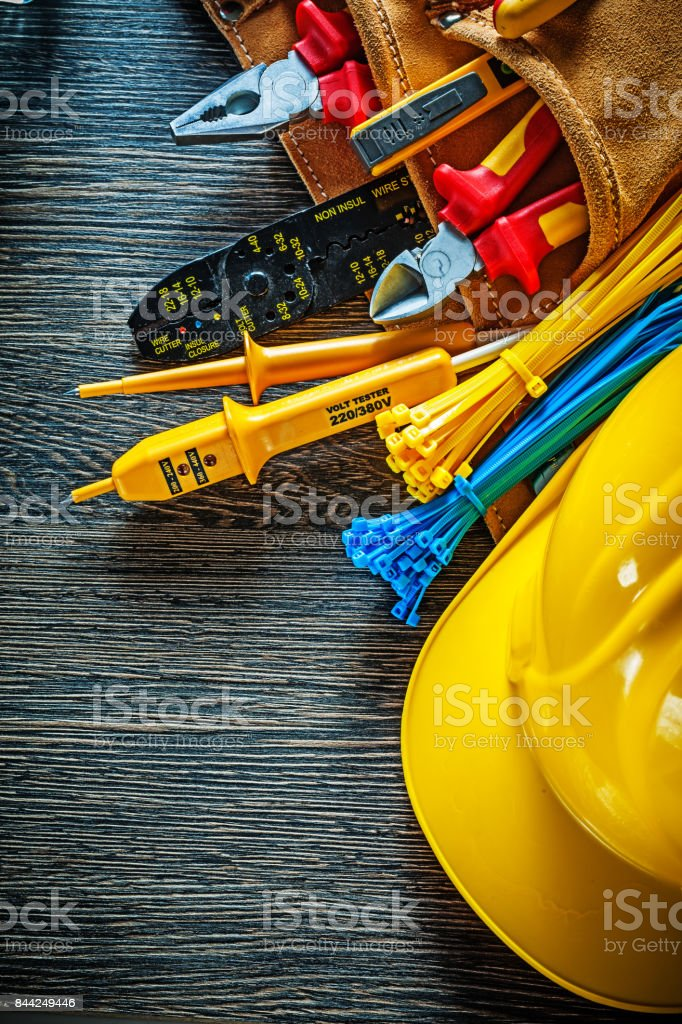 Safety cap leather construction belt on wooden board electricity stock photo