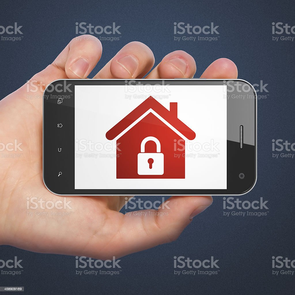 Safety concept: Home on smartphone royalty-free stock photo