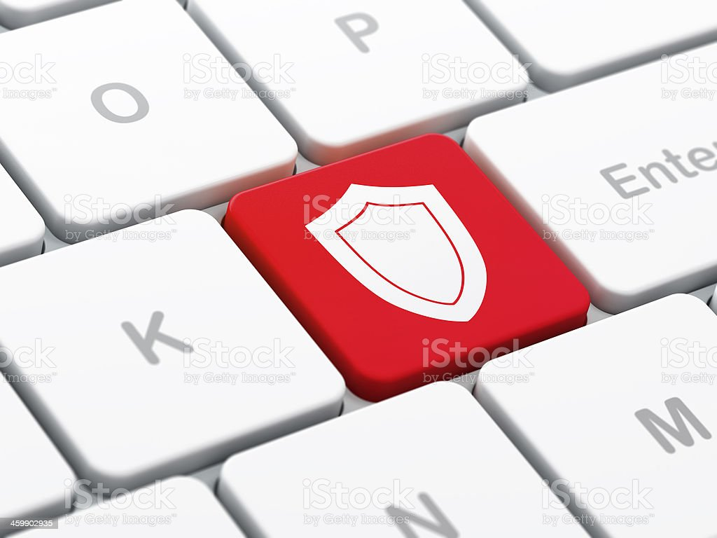 Safety concept: Shield on computer keyboard background royalty-free stock photo