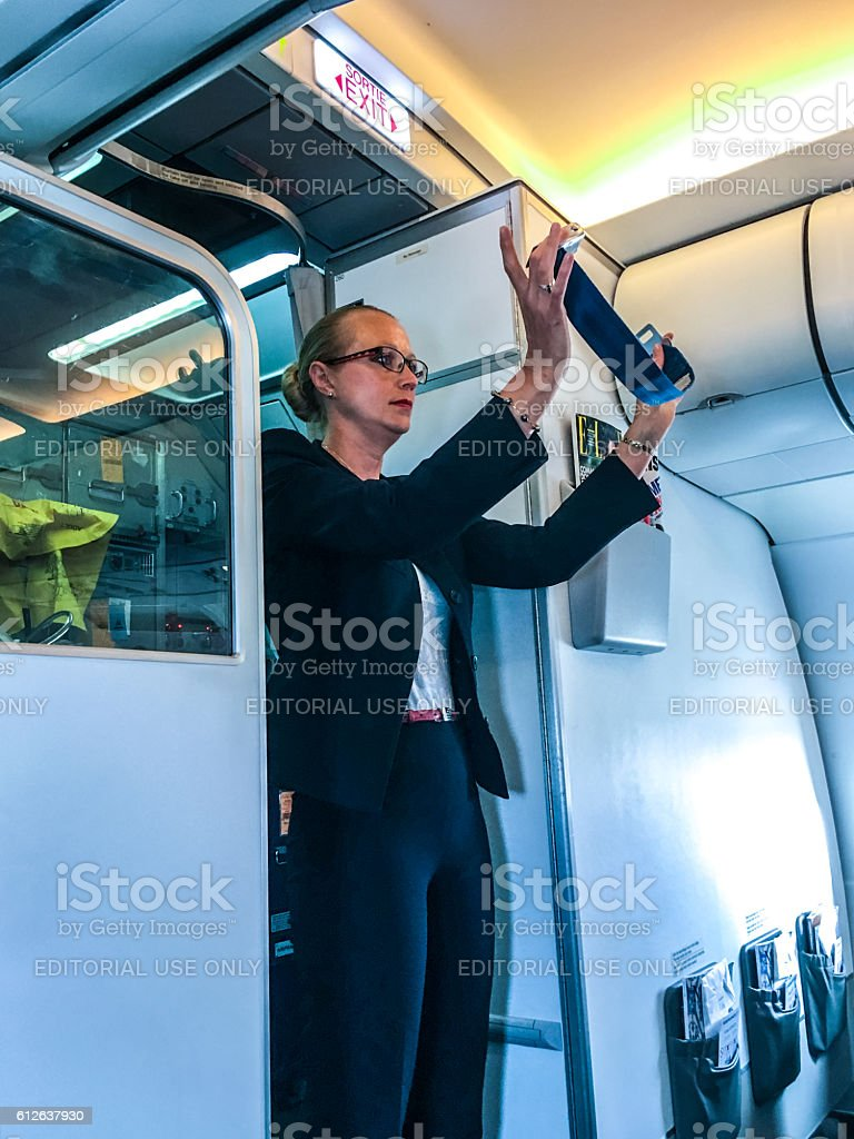 Safety demonstration on board of Air France airplane stock photo