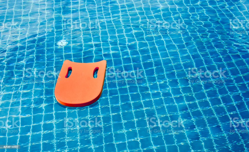 Safety equipment, Life buoy or rescue buoy floating on swimming pool to rescue people from drowning man. stock photo