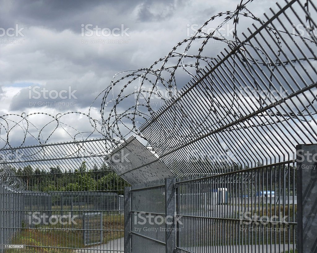 safety fence and dramatic sky royalty-free stock photo