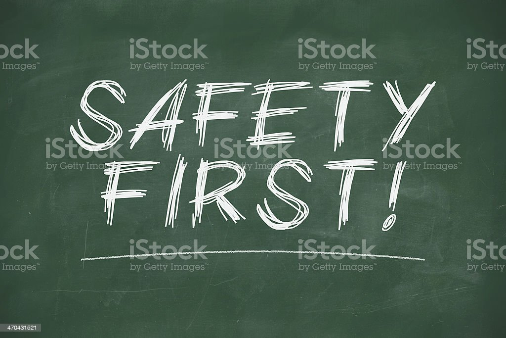 Safety first on blackboard stock photo
