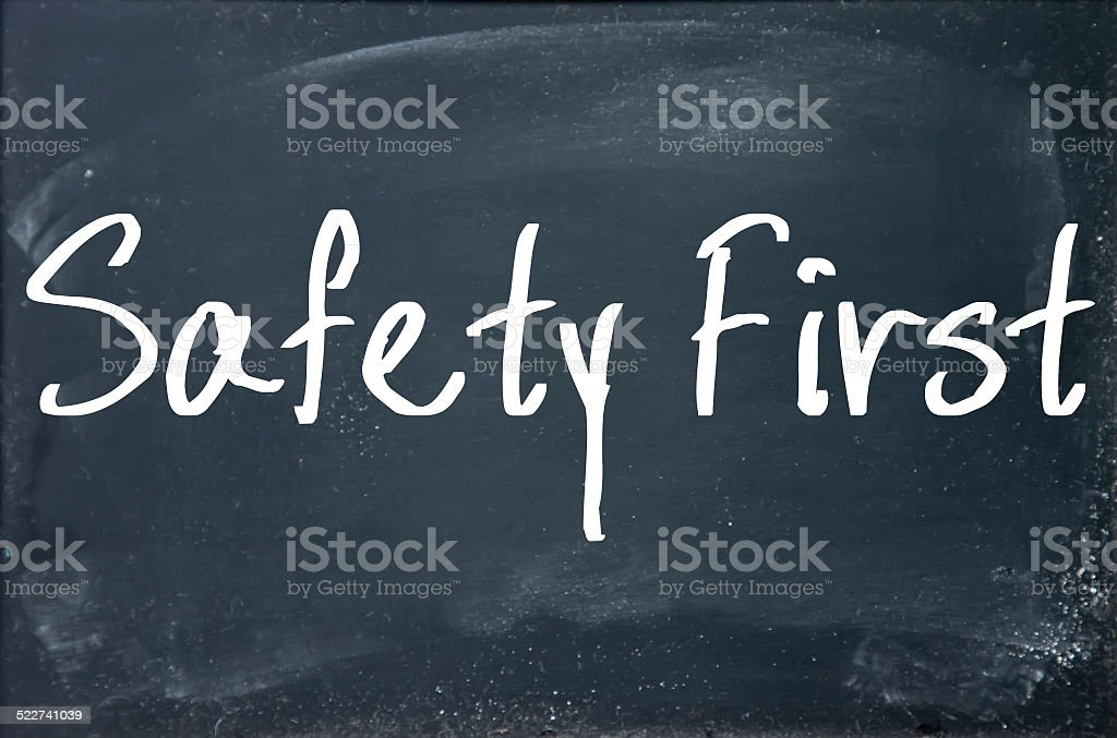 safety first text write on paper stock photo