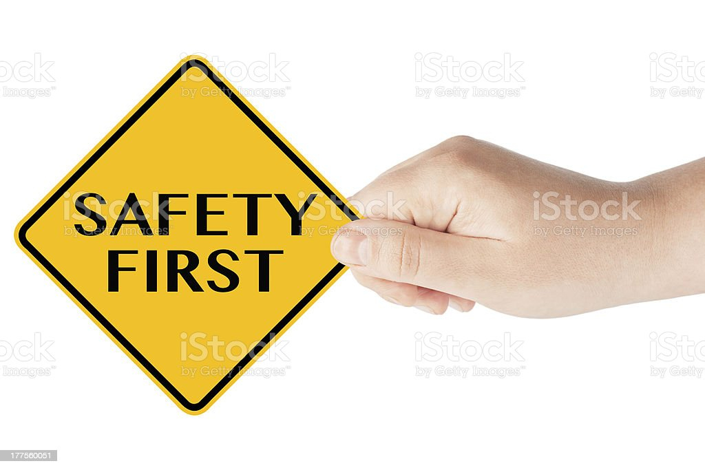 Safety First  traffic sign with hand royalty-free stock photo