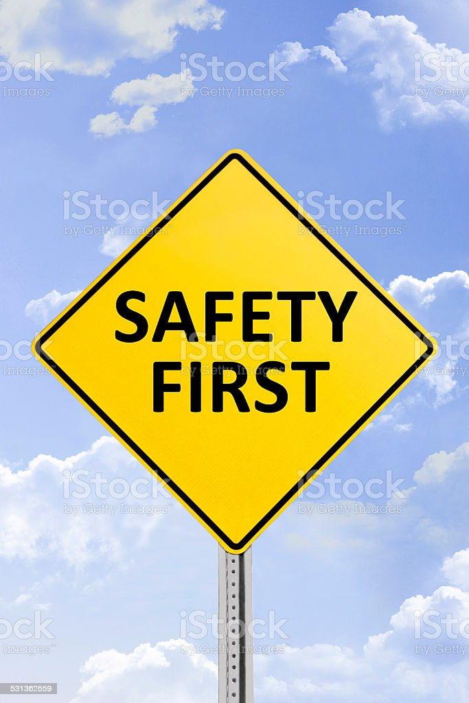 Safety First Yellow Road Sign stock photo